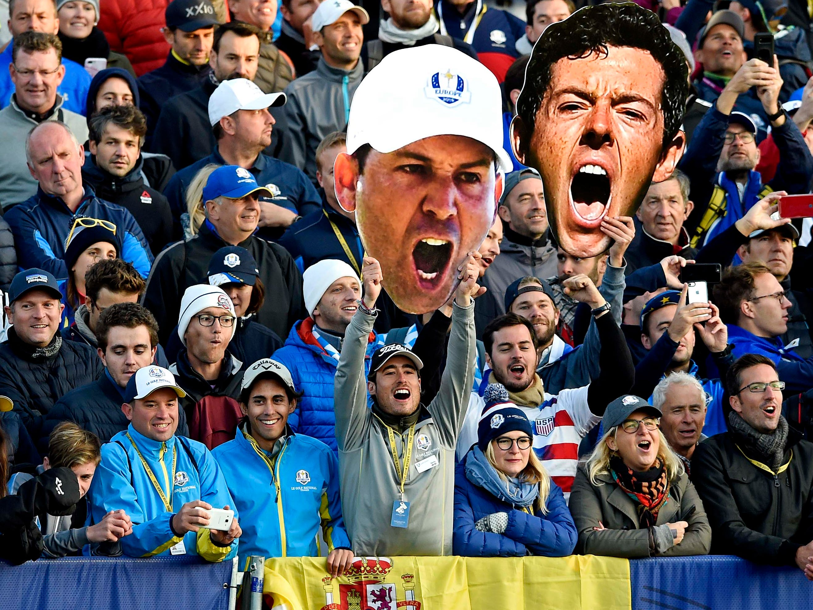 Fans cheer (with huge cutouts of Sergio Garcia and Rory McIlroy) on the first tee during the Ryder Cup matches on Saturday.