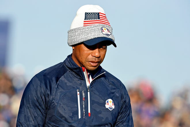 Tiger Woods walks off the second tee during the Ryder Cup Saturday Morning matches at Le Golf National.