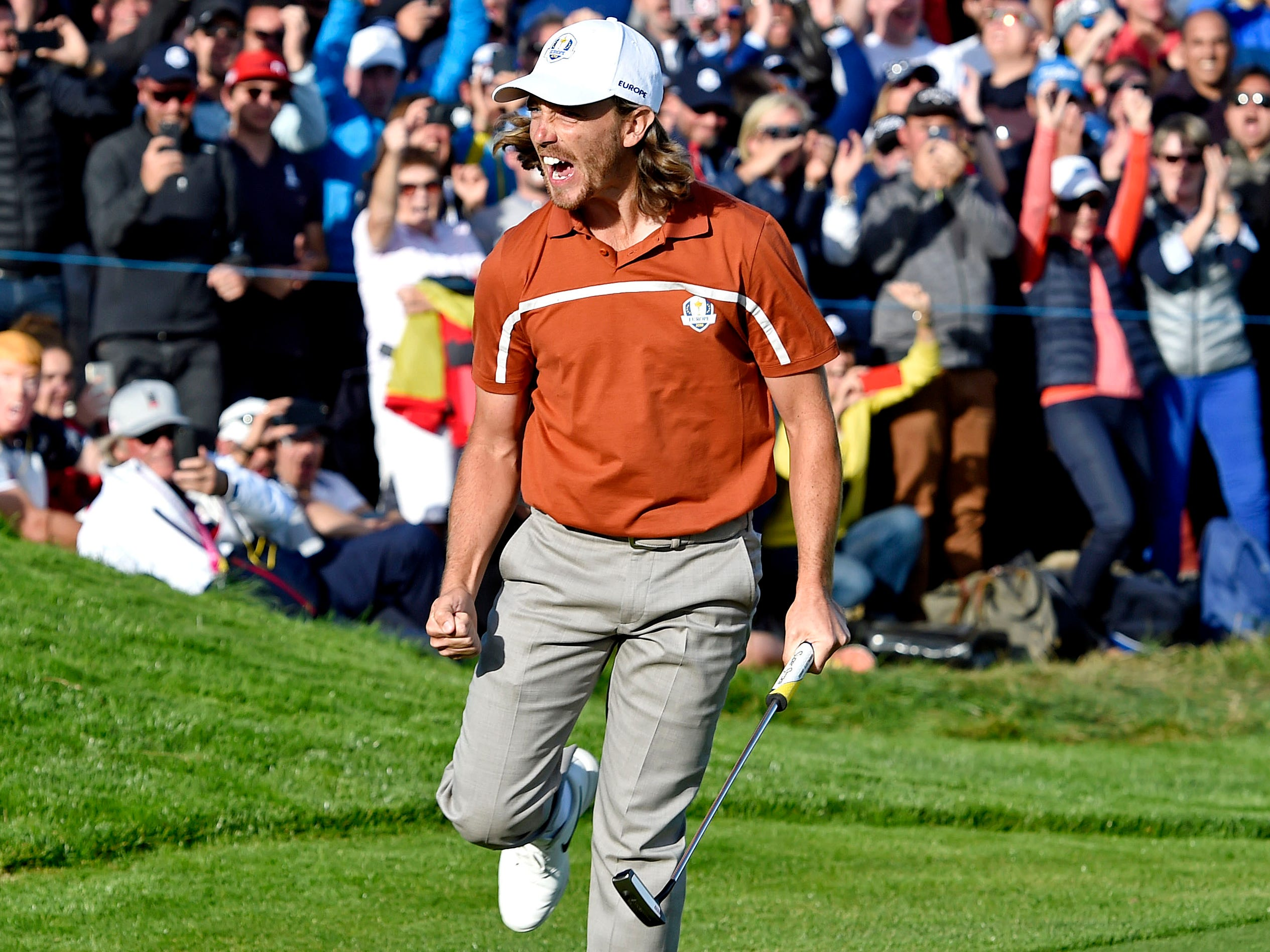 Europe's Tommy Fleetwood celebrates on the 12th green during the Saturday afternoon matches.