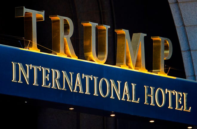 In this file photo taken on March 23, 2017, the sign on the Trump International Hotel is seen at sunset in Washington, D.C. It is the focus of a lawsuit by Democratic lawmakers that President Trump has violated the emoluments of the Constitution by his business dealings with foreign governments.