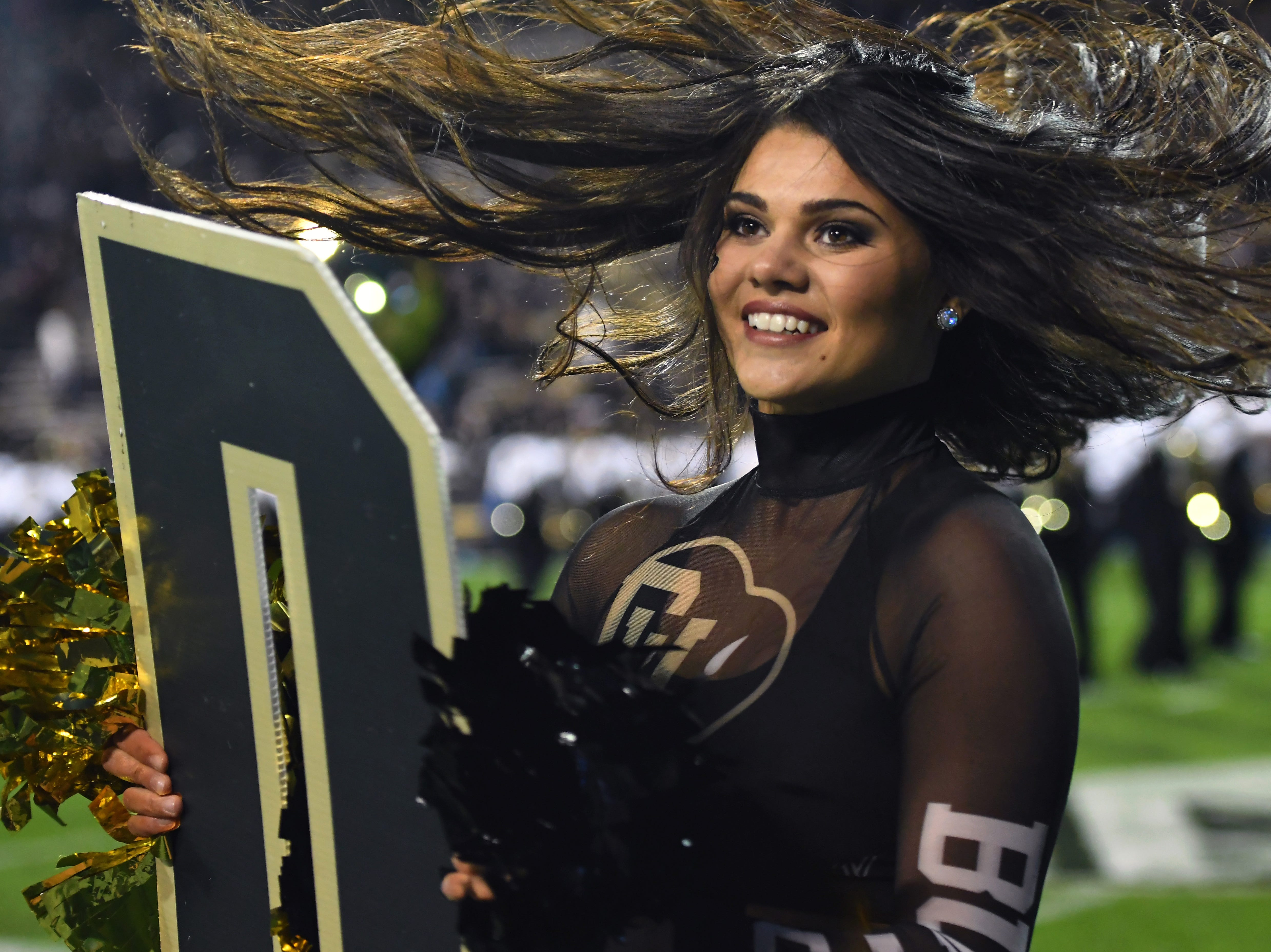 Week 5: A Colorado Buffaloes cheerleader performs before the game against the UCLA Bruins at Folsom Field.
