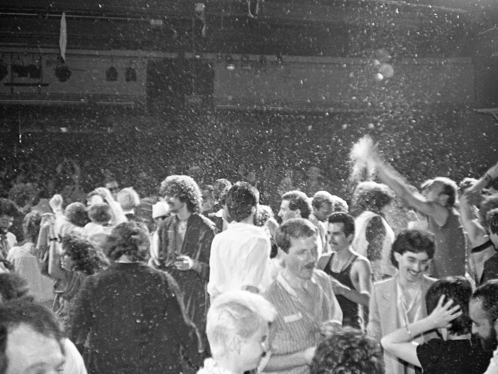The glitter snows upon the crowds at Studio 54.