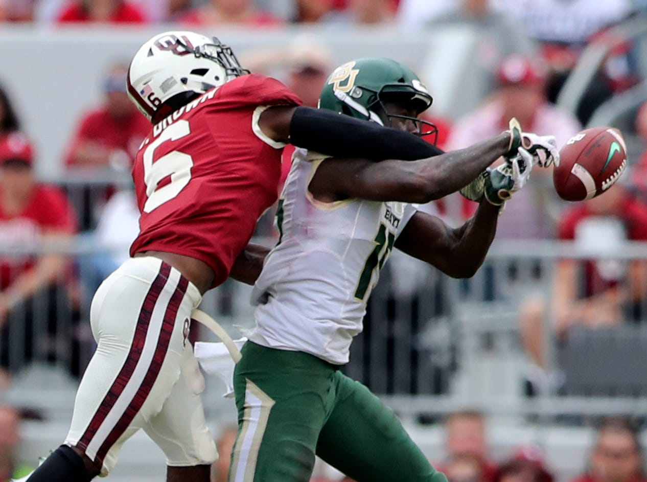 Oklahoma Sooners cornerback Tre Brown (6) defends a pass intended for Baylor Bears wide receiver Denzel Mims (15) during the first half at Gaylord Family-Oklahoma Memorial Stadium.