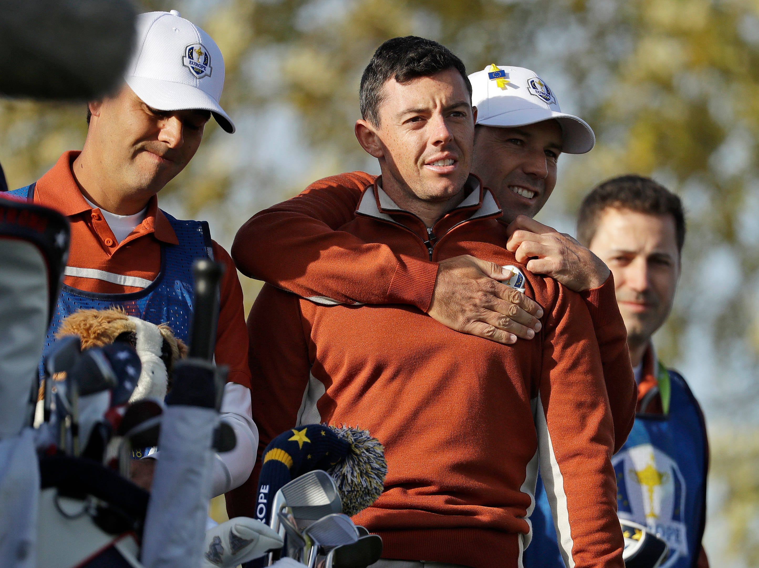 Europe's Sergio Garcia, second right, embraces Europe's Rory McIlroy during a fourball match on the second day of the 42nd Ryder Cup at Le Golf National outside Paris.