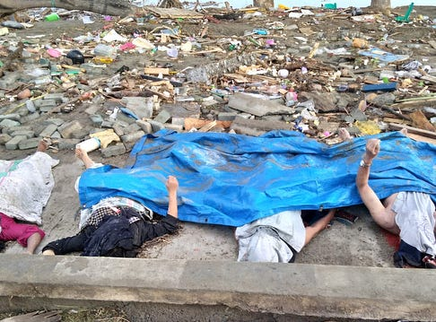 EDITORS NOTE: Graphic content / Bodies of victims of the tsunami are seen in Palu, on Sulawesi island in central Indonesia.
