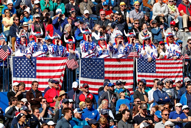USA fans cheer on the first tee during the Ryder Cup Saturday afternoon matches at Le Golf National.
