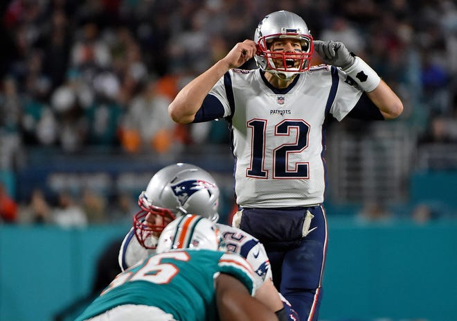 New England Patriots quarterback Tom Brady (12) calls a play in the game against the Miami Dolphins during the second half at Hard Rock Stadium.