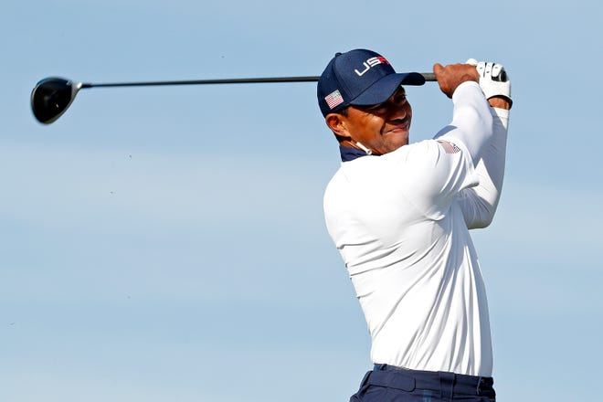 United States golfer Tiger Woods plays his shot from the seventh tee during the Ryder Cup Saturday Morning matches at Le Golf National.