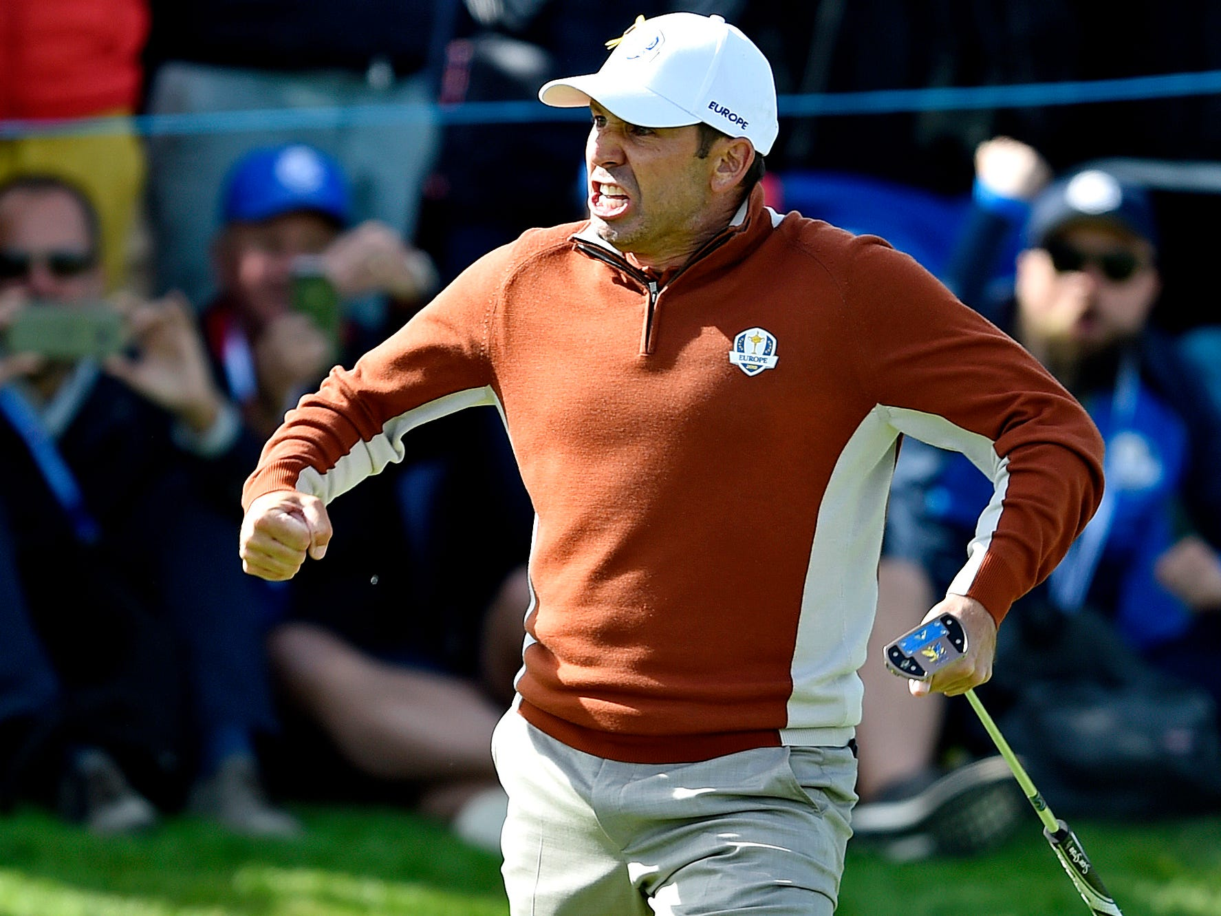 Sergio Garcia celebrates after making a putt on the 17th green to win his morning fourball match.