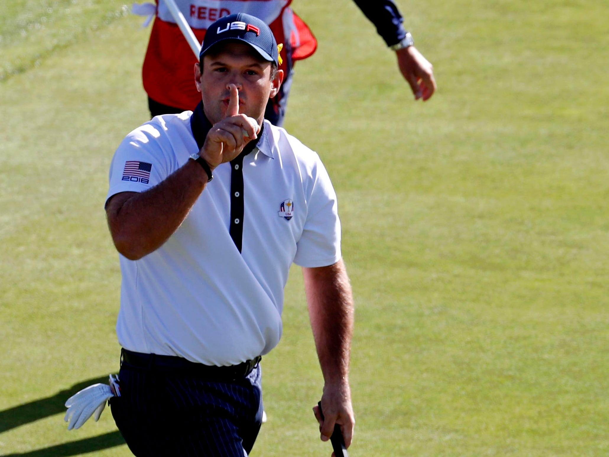 Patrick Reed tried to quiet the crowd with this putt on the ninth green on Saturday morning ...