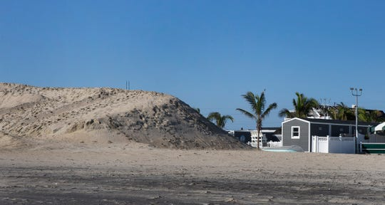 Dune built up in front Chapel Beach Club in Sea Bright, a dune so high it might cause problems for beach areas south of it.