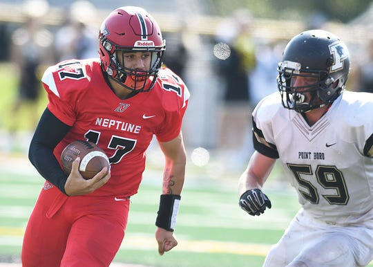 Neptune QB Nino Bua looks for running room as Point Pleasant Boro's Scott Franceschini moves in on defense. Neptune Football defeats Point Pleasant Boro 24-21 on 9/29/2018. Neptune rallied from a 13-0 halftime deficit, with Kevin Clohosey kicking a 28-yard field goal with no time left