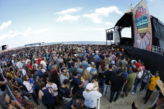 Concert goers watch The English Beat  perform at the Sea Hear Now Festival on the  Beach in Asbury Park, Saturday, Sept. 29, 2018