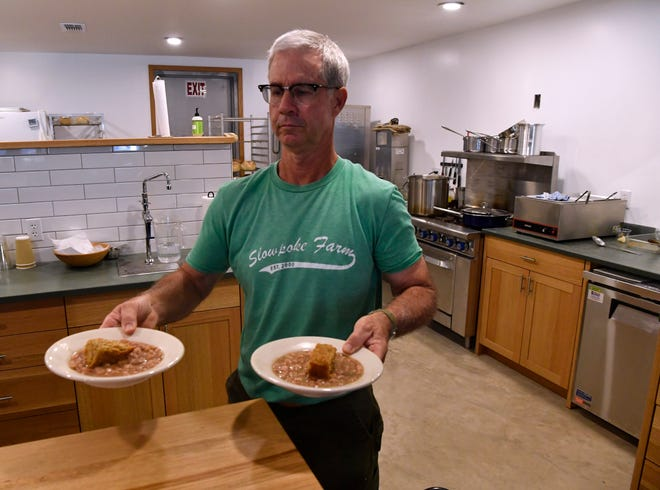 Kerry Hedges serves two bowls of beans and cornbread Thursday at Slowpoke Farm Market in Cisco. He and his wife Joy opened the business on Labor Day.