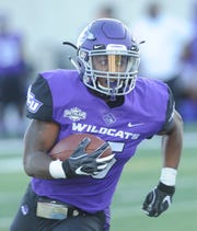 ACU's Tyrese White races toward the end zone for a 22-yard touchdown pass from Luke Anthony. The score gave the Wildcats a 14-7 lead with 1:43 left in the first quarter of the Southland Conference game Saturday, Sept. 29, 2018, at Wildcat Stadium.