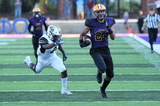 Hardin-Simmons safety Dedrick Strambler (24) runs after intercepting an East Texas Baptist pass on Saturday, Sept. 29, 2018. The Cowboys won 59-17.