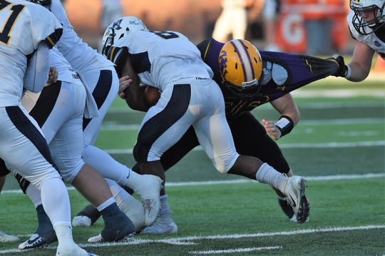 Hardin-Simmons defensive lineman Hunter Creasey (96) tackles East Texas Baptist back Dominic Haggerty while being held on Saturday, Sept. 29, 2018. The Cowboys won 59-17.