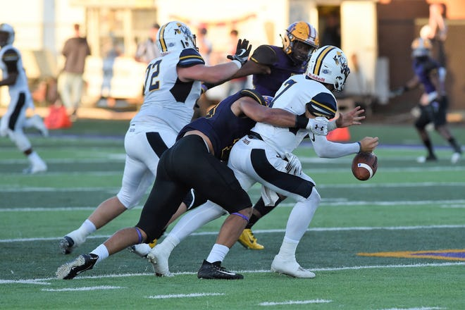 Hardin-Simmons linebacker Eriq Mitchell (13) sacks East Texas Baptist quarterback Brian Baca (7) and forces a fumble on Saturday, Sept. 29, 2018. The Cowboys won 59-17.