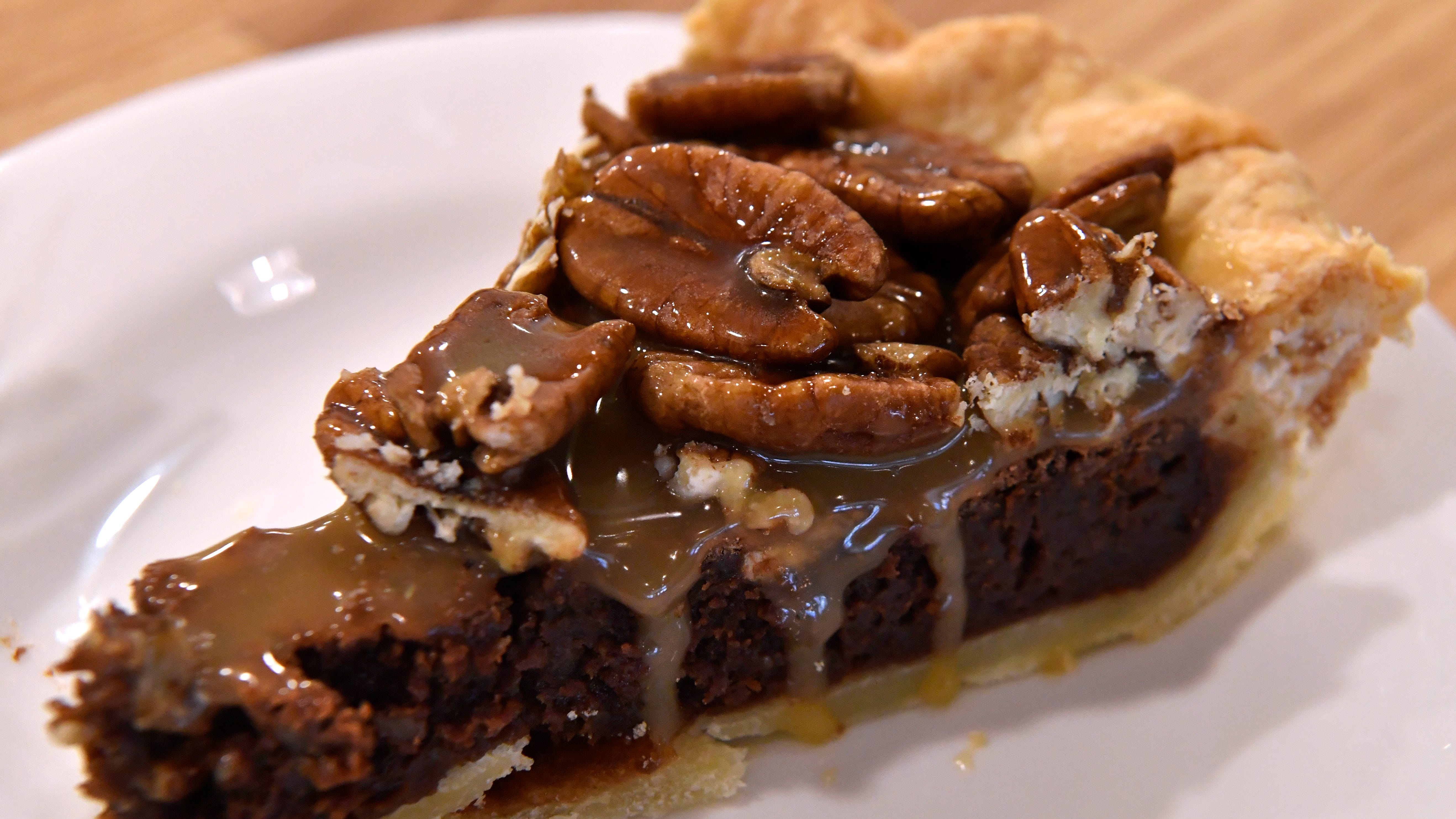 Kerry Hedges' sea salt chocolate pecan caramel pie Sept. 27, 2018. Slowpoke Farm Market features homemade pies, bread, and other foods.