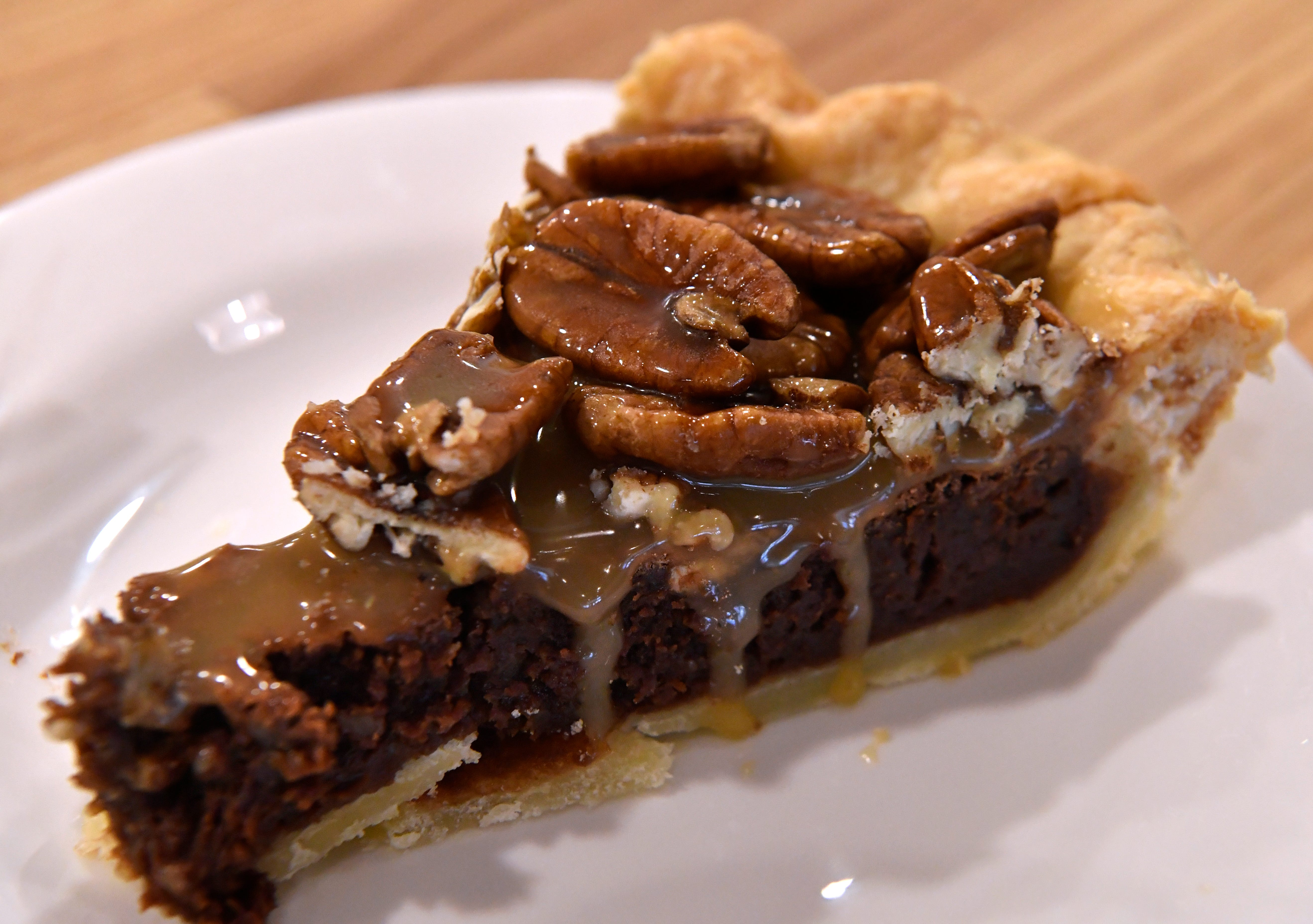 Kerry Hedges' sea salt chocolate pecan caramel pie. Slowpoke Farm Market features homemade pies, bread, and other foods.
