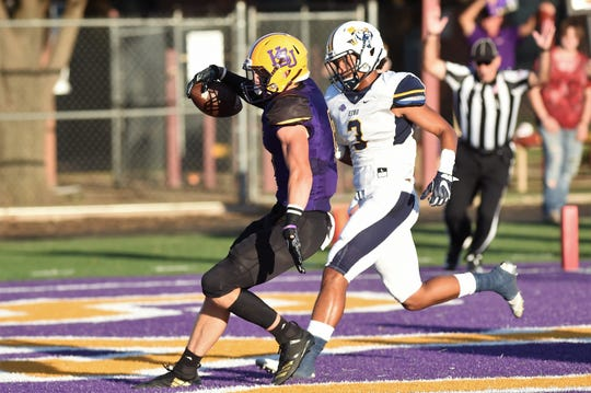 Hardin-Simmons safety Blake Johnston (6) celebrates after returning an interception for a touchdown against East Texas Baptist on Saturday, Sept. 29, 2018. The Cowboys won 59-17.