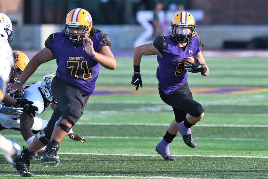 Hardin-Simmons offensive lineman Juan Martinez (71) gets out in front of receiver Reese Childress (5) against East Texas Baptist. Martinez has stepped into the starting lineup due to an injury.