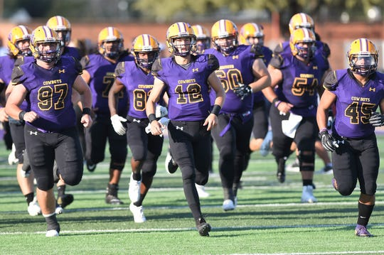 Hardin-Simmons quarterback Ty Hooper (12) leads the team onto the field  before the East Texas Baptist game on Saturday, Sept. 29, 2018. The Cowboys won 59-17.