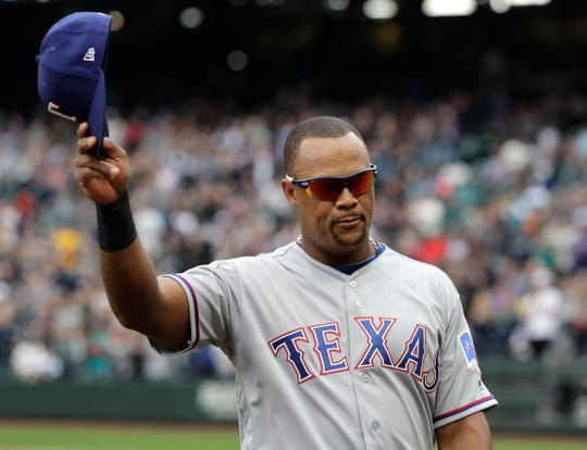 Texas Rangers' Adrian Beltre tips his cap as he walks off the field during the fifth inning of a baseball game against the Seattle Mariner. Beltre, who played five seasons in Seattle before joining the Rangers, is considering retirement.