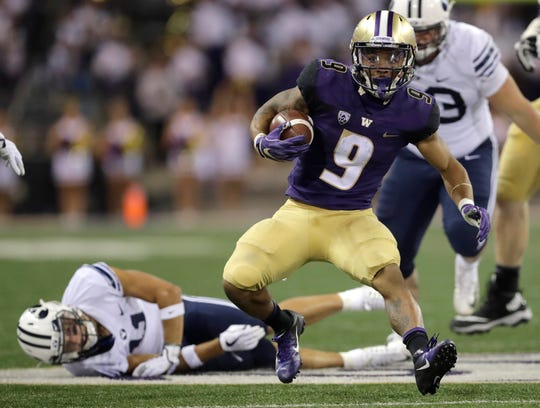 Washington running back Myles Gaskin (9) cuts into the Brigham Young secondary.