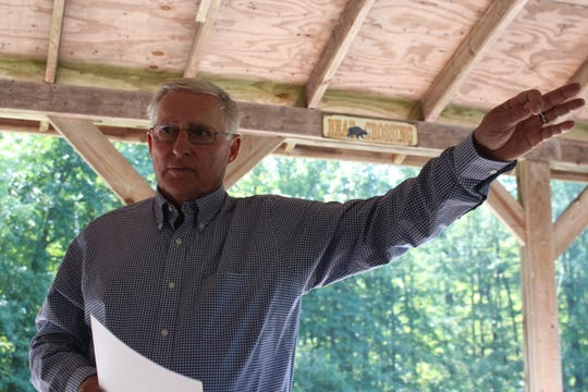Local volunteer Jim Gerstenslager shares his memories of Seccaium Park on Sunday, Sept. 30, 2018. Ed and Dee Speece, who now own the property, opened the former park to the public for a talk Sunday.