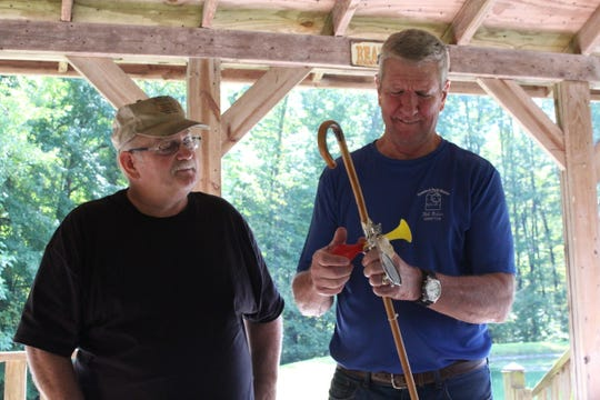Ed Speece, left, gives Crawford Park District director Bill Fisher a retirement present Sunday, Sept. 30, 2018. Fisher is retiring in October.