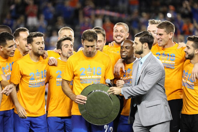FC Cincinnati players get ready to accept the 2018 USL Regular Season trophy after their match against Indy Eleven at Nippert Stadium on Saturday. FC Cincinnati won the match with a final score of 3-0.