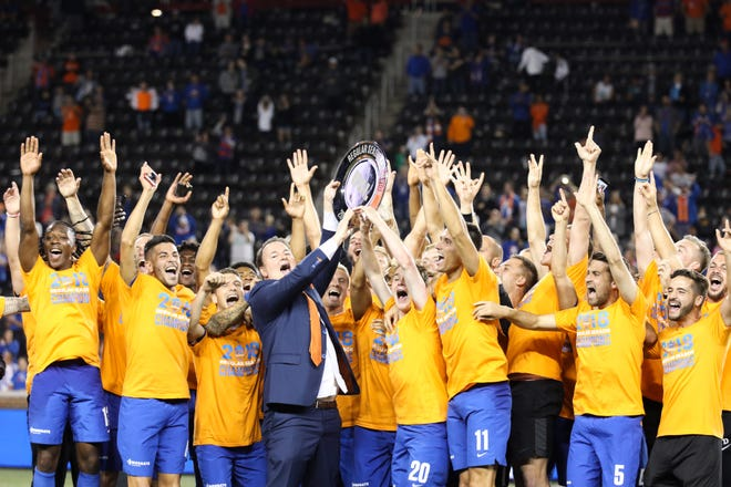 FC Cincinnati is awarded the 2018 USL Regular Season trophy after their match against Indy Eleven at Nippert Stadium on Saturday. FC Cincinnati won the match with a final score of 3-0.