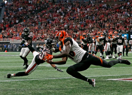 Cincinnati Bengals wide receiver A.J. Green (18) catches the game-winning touchdown pass with seven seconds remaining in the fourth quarter of the NFL Week 5 game between the Atlanta Falcons and the Cincinnati Bengals at Mercedes-Benz Stadium in Atlanta on Sunday, Sept. 30, 2018. The Bengals scored a touchdown in the final seconds of the fourth quarter to win 37-36.