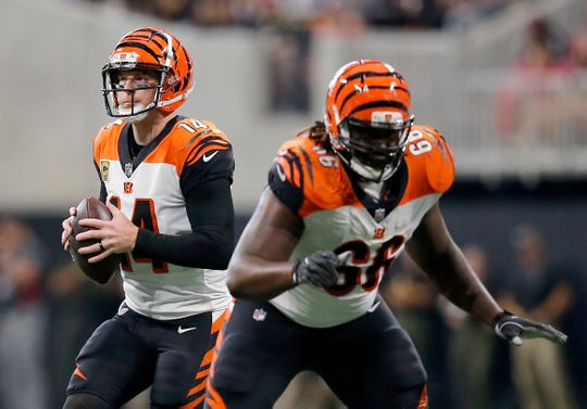 Cincinnati Bengals quarterback Andy Dalton (14) drops back to pass in the second quarter of the NFL Week 5 game between the Atlanta Falcons and the Cincinnati Bengals at Mercedes-Benz Stadium in Atlanta on Sunday, Sept. 30, 2018.