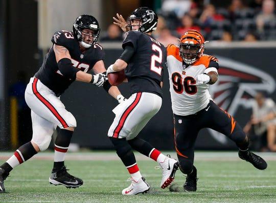 Cincinnati Bengals defensive end Carlos Dunlap (96) pursues Atlanta Falcons quarterback Matt Ryan (2) in the second quarter of the NFL Week 5 game between the Atlanta Falcons and the Cincinnati Bengals at Mercedes-Benz Stadium in Atlanta on Sunday, Sept. 30, 2018.