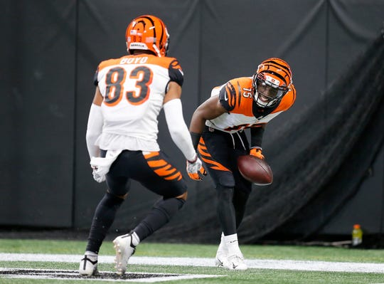 Cincinnati Bengals wide receiver John Ross (15) celebrates with wide receiver Tyler Boyd (83) after a touchdown catch in the second quarter of the NFL Week 5 game between the Atlanta Falcons and the Cincinnati Bengals at Mercedes-Benz Stadium in Atlanta on Sunday, Sept. 30, 2018.