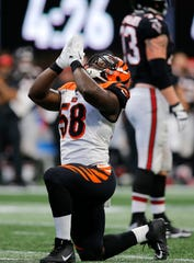 Cincinnati Bengals defensive end Carl Lawson (58) celebrates after a sack in the fourth quarter of the NFL Week 5 game between the Atlanta Falcons and the Cincinnati Bengals at Mercedes-Benz Stadium in Atlanta on Sunday, Sept. 30, 2018. The Bengals scored a touchdown in the final seconds of the fourth quarter to win 37-36.