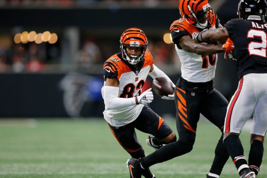 Cincinnati Bengals wide receiver Tyler Boyd (83) cuts inside with a block from wide receiver A.J. Green (18) on a catch in the first quarter of the NFL Week 5 game between the Atlanta Falcons and the Cincinnati Bengals at Mercedes-Benz Stadium in Atlanta on Sunday, Sept. 30, 2018.