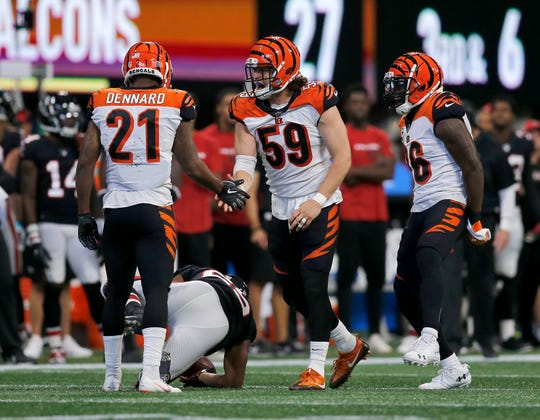 Cincinnati Bengals linebacker Nick Vigil (59) and defensive back Darqueze Dennard (21) celebrate a stop in the third quarter of the NFL Week 5 game between the Atlanta Falcons and the Cincinnati Bengals at Mercedes-Benz Stadium in Atlanta on Sunday, Sept. 30, 2018. The Bengals scored a touchdown in the final seconds of the fourth quarter to win 37-36.