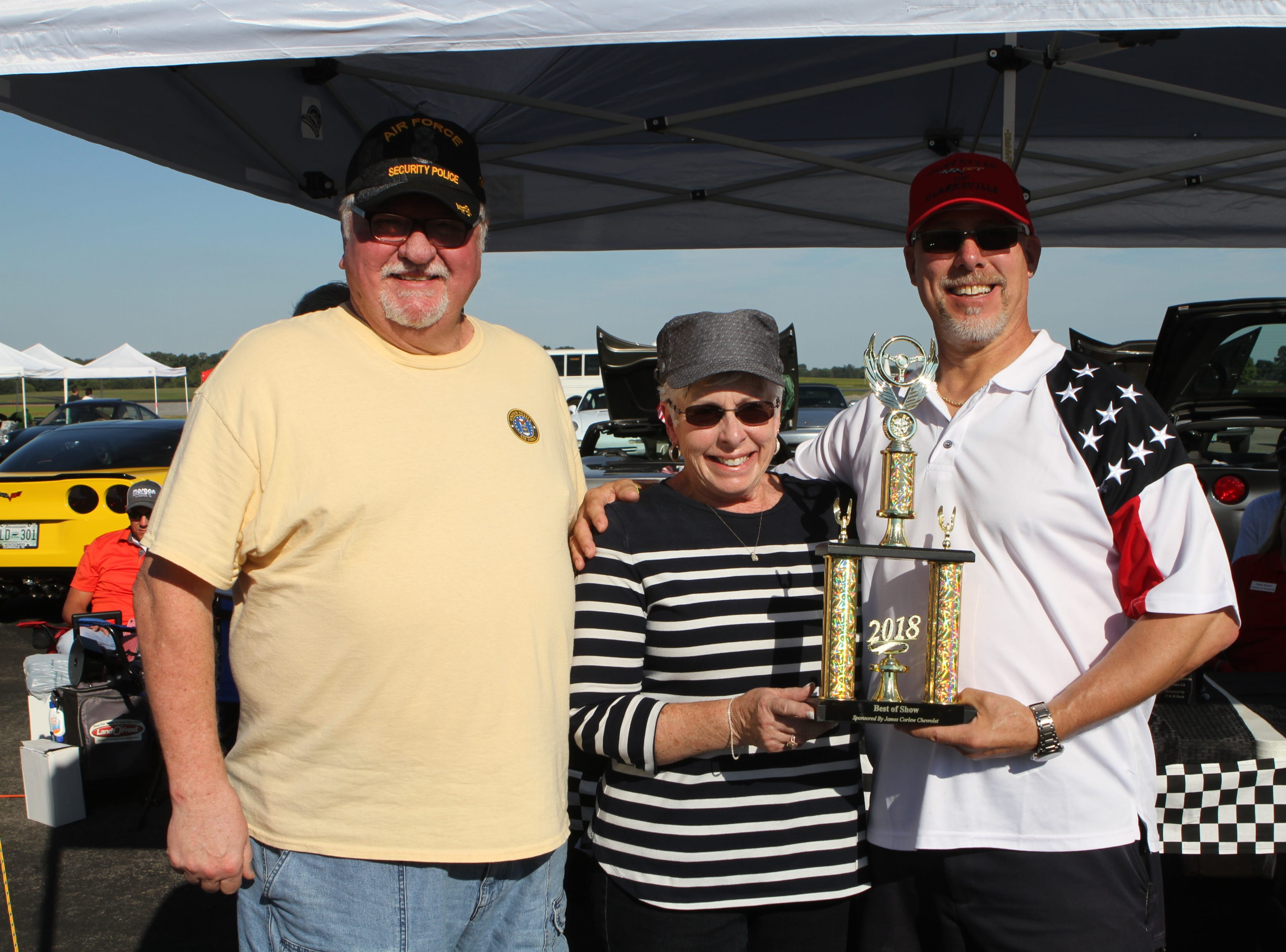 Richard and Pat Ball's 1973 Corvette earned the Best of Show trophy, presented by Michael Kunkel, at Wags and Wings, a family fun and Oktoberfest event to benefit the Humane Society of Clarksville-Montgomery County, Saturday, Sept. 29, 2018.