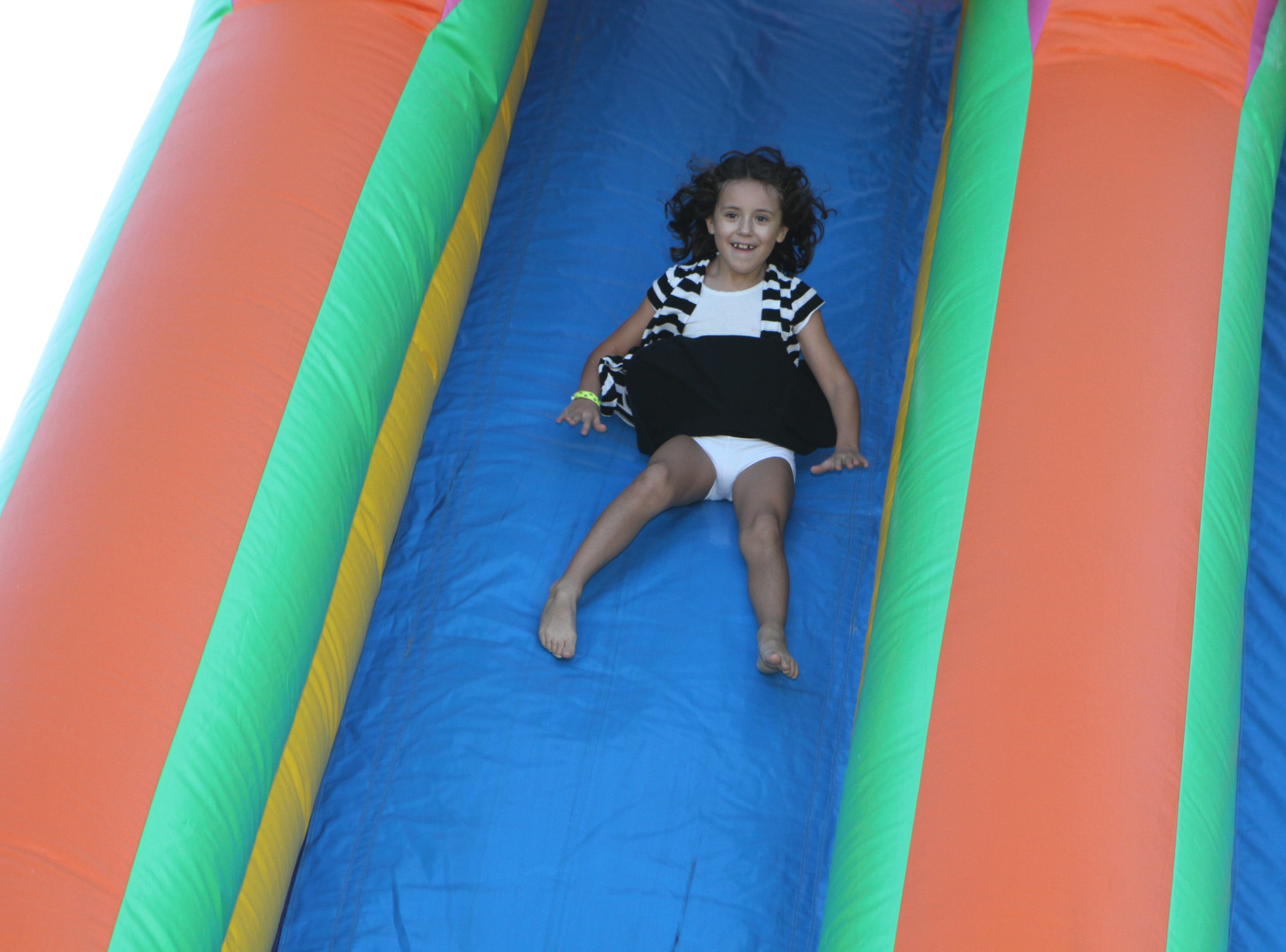Alyssa Duffy enjoys the inflatables at Wags and Wings, a family fun and Oktoberfest event to benefit the Humane Society of Clarksville-Montgomery County, Saturday, Sept. 29, 2018.