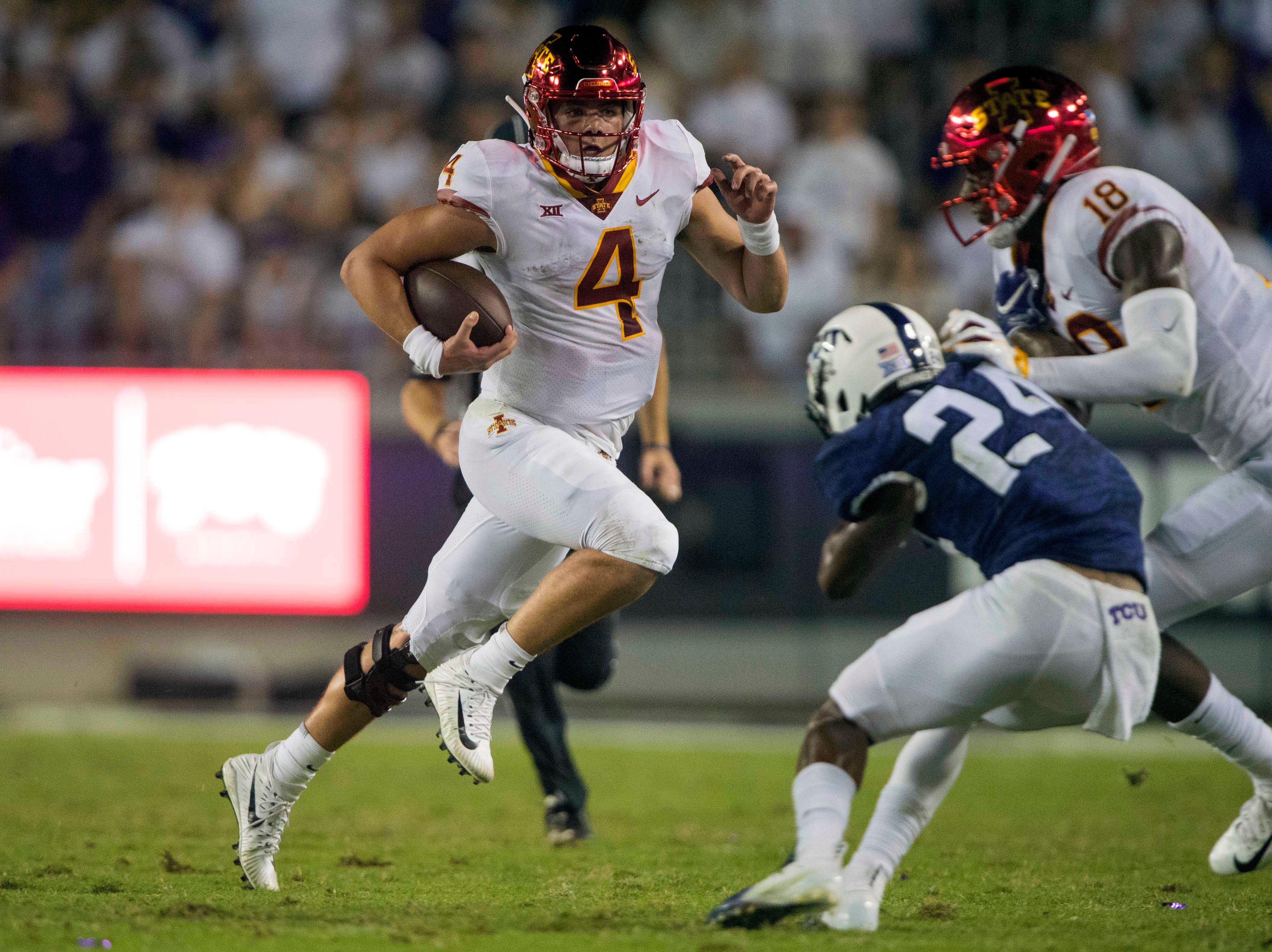 Iowa State Cyclones quarterback Zeb Noland (4) runs for a first down against the TCU Horned Frogs defense during the second half at Amon G. Carter Stadium.