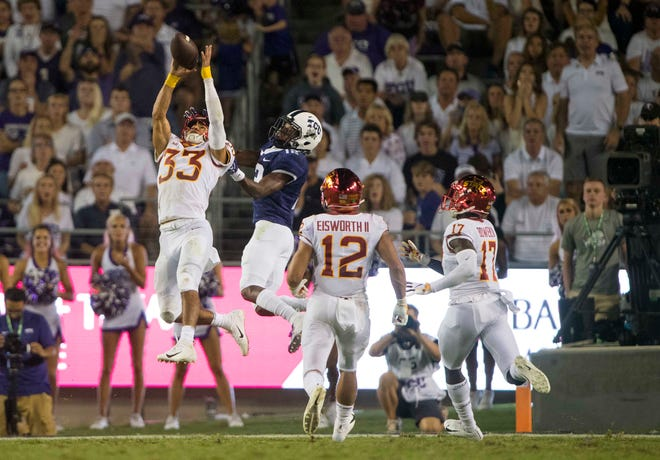 Iowa State Cyclones defensive back Braxton Lewis (33) intercepts a pass intended for TCU Horned Frogs cornerback Jeff Gladney (12) during the second half at Amon G. Carter Stadium.