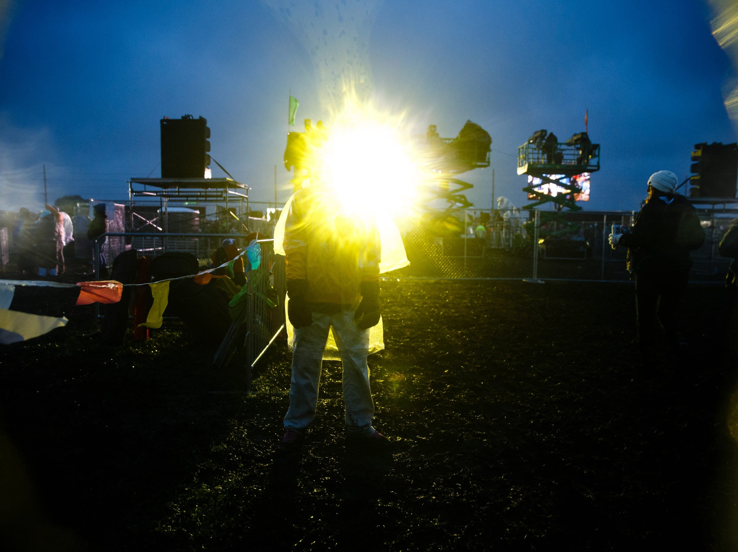 Security guards stand in the rain before Chase Rice performs during Luke Bryan's Farm Tour on Saturday, Sept. 29, 2018 in Boone.