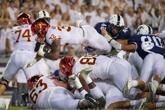 Iowa State Cyclones running back David Montgomery (32) scores a rushing touchdown as TCU Horned Frogs linebacker Ty Summers (42) and linebacker Garret Wallow (30) defend during the second half at Amon G. Carter Stadium.