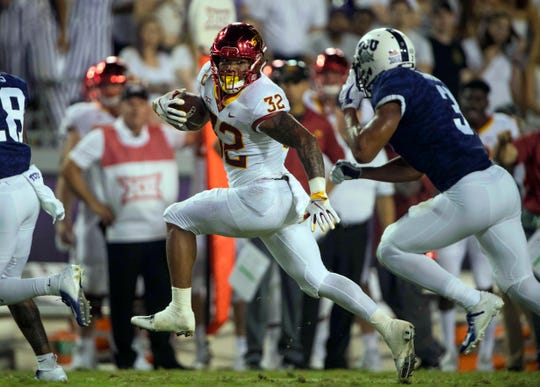 Iowa State Cyclones running back David Montgomery (32) evades TCU Horned Frogs safety Markell Simmons (3) during the second half at Amon G. Carter Stadium.