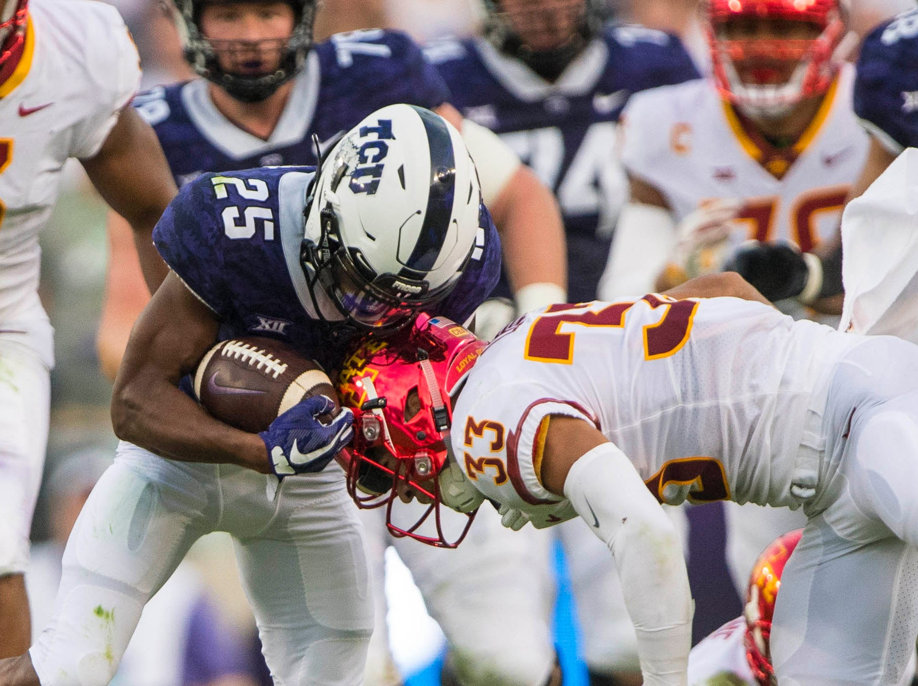 TCU Horned Frogs wide receiver KaVontae Turpin (25) is hit by Iowa State Cyclones defensive back Braxton Lewis (33) during the first half at Amon G. Carter Stadium. Upon review Lewis was not called for targeting.