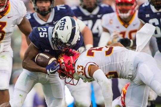 TCU Horned Frogs wide receiver KaVontae Turpin (25) is hit by Iowa State Cyclones defensive back Braxton Lewis (33) during the first half at Amon G. Carter Stadium.