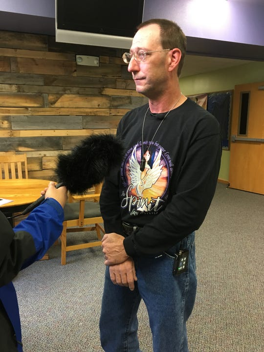 A teary-eyed Joe Busch, the biological father of the deceased, speaks to media about his memories of Sabrina before his daughter's celebration of life service.